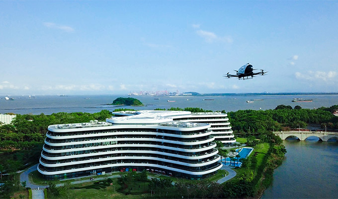 Eight journalists took rides on EHang 216 for aerial trips over LN Garden Hotel