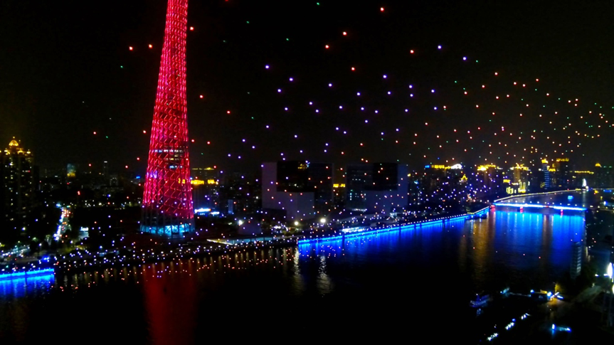 """The """"Meteor Sky"""" 1000 UAV formation reflecting the night view of the Canton Tower and the Pearl River"""