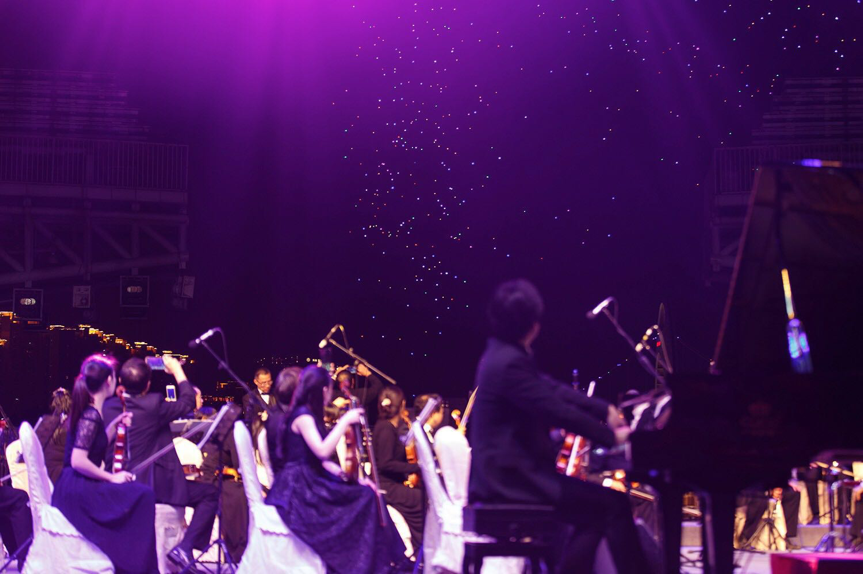The Guangzhou Symphony Orchestra and the UAV formation performing simultaneously